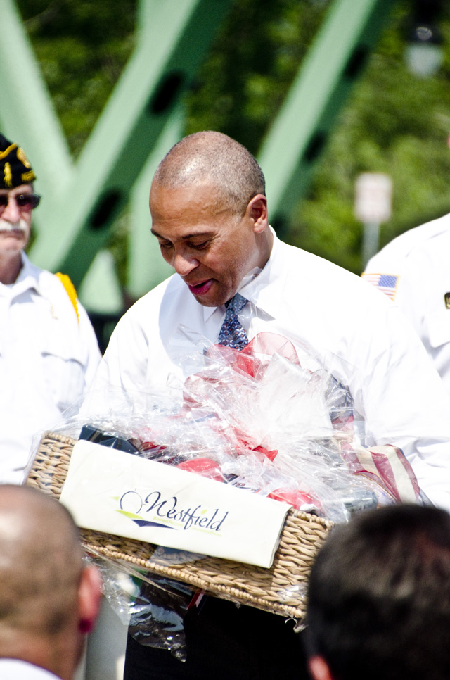 Governor Deval Patrick looks at a gift basket
